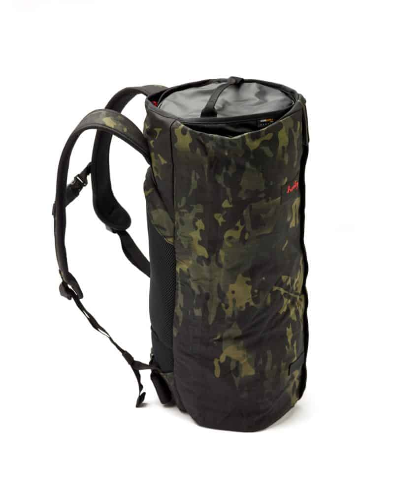 A standing rolled up CoPilot Backpack in Camo (Limited Edition).